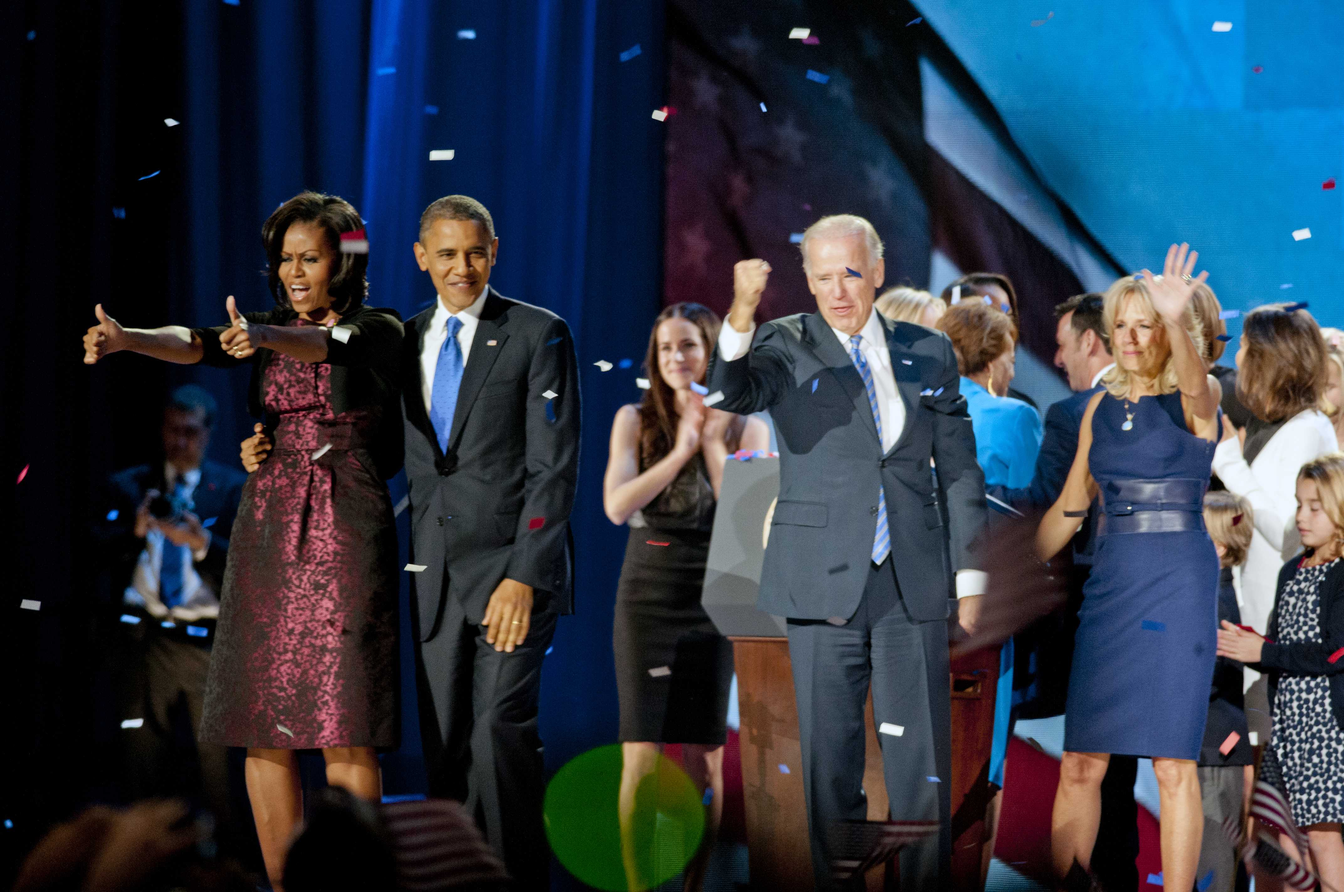 First lady Michelle Obama, President Barack Obama and Vice President Joe Biden (left to right in foreground) greet supporters at an Election Night watch party at McCormick Place in Chicago. The president was elected to a second term Tuesday;