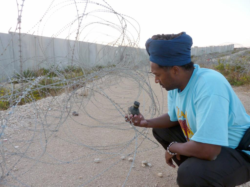 Gilo Kwesi Logan, professor at Northeastern Illinois University, holds a tear gas canister that the Israeli military shot during a protest in the  West Bank village of Bilin. Logan was part of a civilian delegation sent to the Middle East to observe life in a conflict zone.