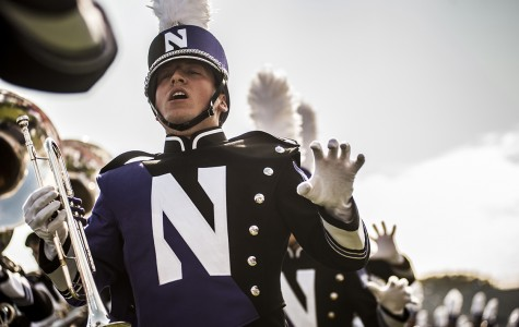 The Northwestern University Marching Band plays the school fight song before the football game against Indiana on Sept. 29. The fight song will turn 100 years old later this month, and a contest is being held for fans to submit their own renditions.