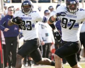 Football: Wildcats overcome demons, beat Spartans