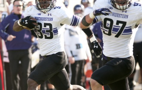 Northwestern linebacker David Nwabuisi (33) returns a third-quarter interception for a touchdown. The Wildcats forced four turnovers in Saturday's game.