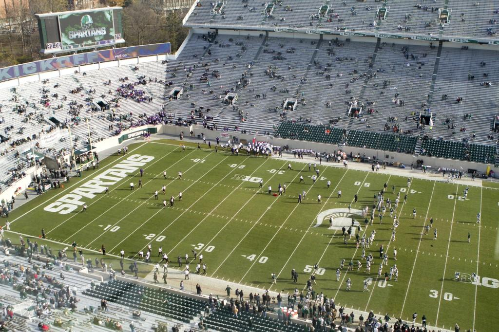 The Wildcats and Spartans warm up before Saturday's game in East Lansing, Mich. The on-the-road match-up is the second-to-last game of Northwestern's regular season.