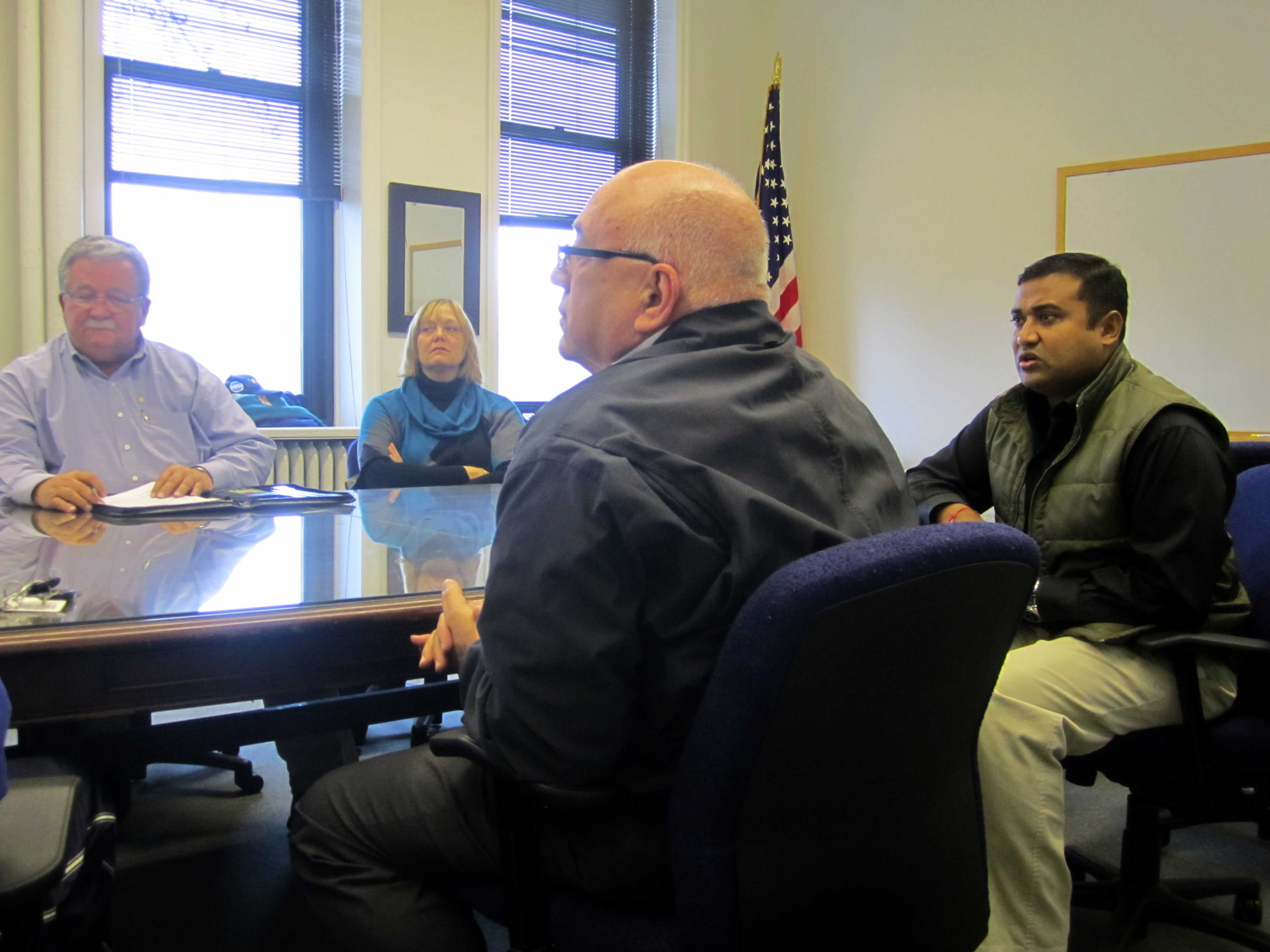 7-Eleven field consultant Mike Drop (second from right) and franchisee Prakash Mohanty (far right) state their case to the city's Liquor Control Board for serving alcoholic beverages at Mohanty's store on Emerson Street.