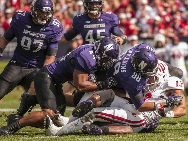 The Northwestern defensive line is tasked with trying to contain the explosive running ability of Michigan quarterback Denard Robinson in Saturday's contest.