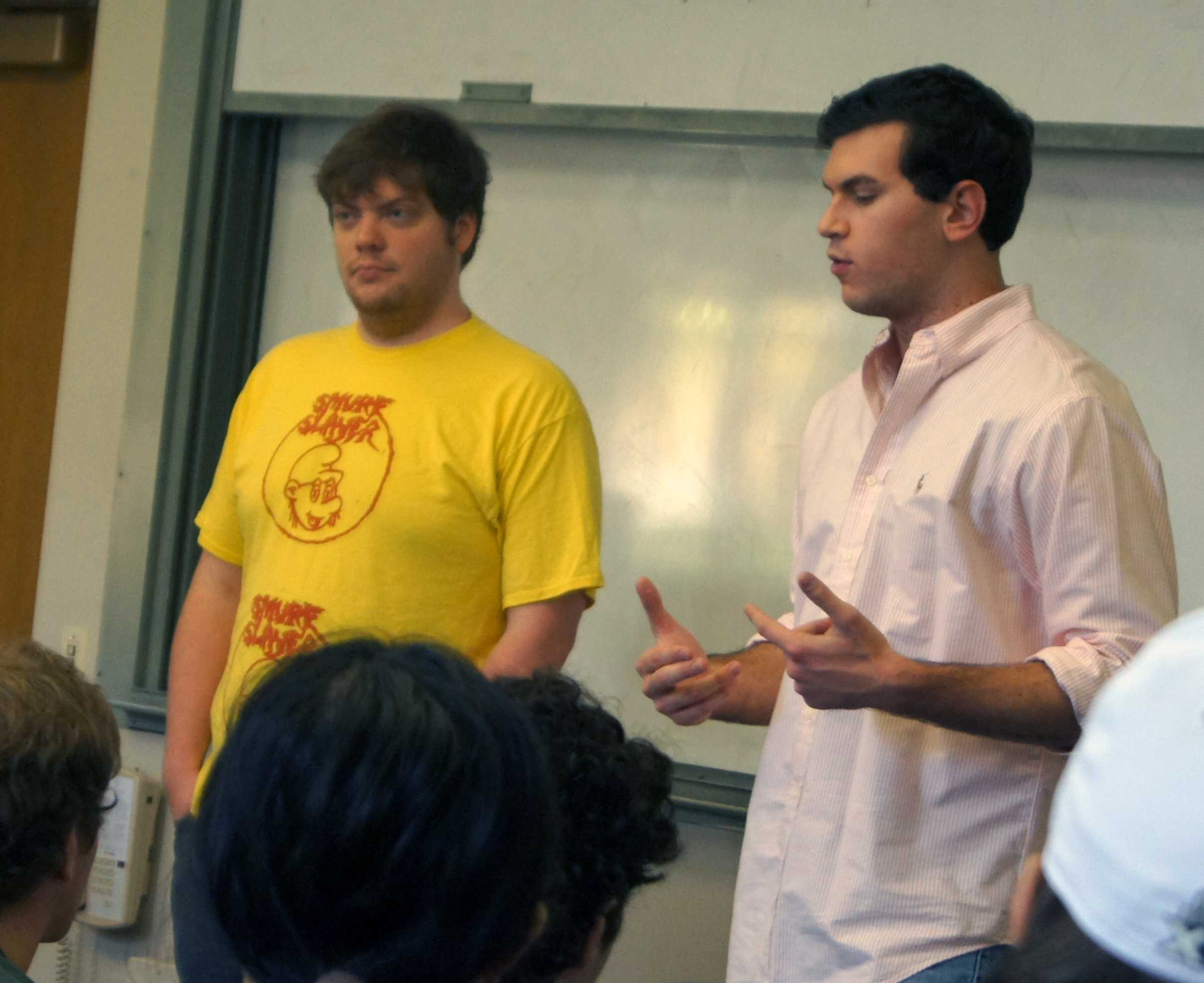Weinberg senior Tim White (left) and Medill senior Matthew Hays (right) introduce improv group No Fun Mud Piranhas' goals for the coming year at a recent meeting. White and Hays are reviving a group that both David Schwimmer and Stephen Colbert participated in during their time at Northwestern.