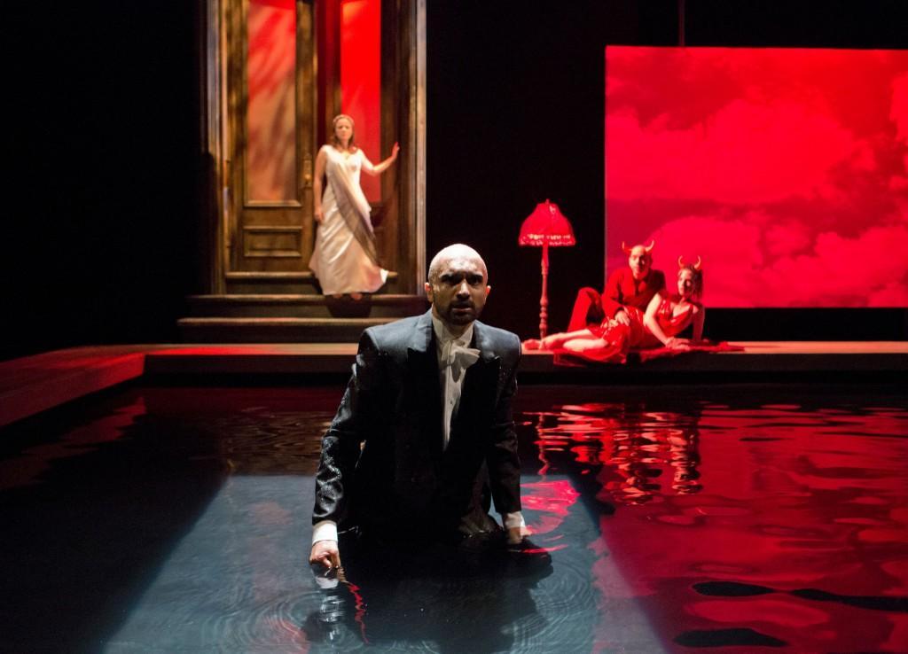 "Orpheus (Usman Ally) pleads to Hades (Douglas Hara) for his dead wife, Eurydice (Lauren Orkus) in ""Metamorphoses."""