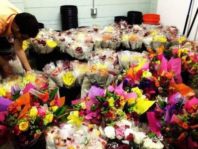 A staff member at Flowers for Dreams sorts bouquets. The Evanston business opened in March.
