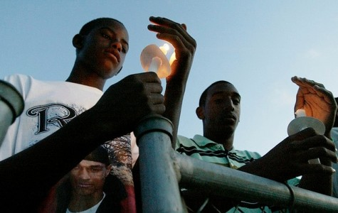 Evanston teenager Justin Murray (right) reflects during a community vigil for the death of 17-year-old Darryl Shannon Picket in 2007. Murray was gunned down Thursday near Evanston Township High School.