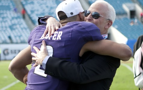 Northwestern quarterback Kain Colter hugs Northwestern President Morton Schapiro after the Wildcats' win over Mississippi State at the Gator Bowl on Tuesday.