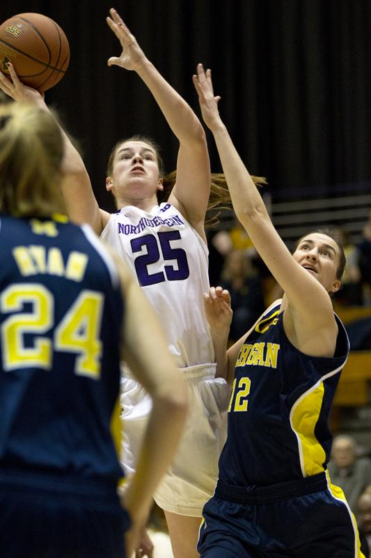 Freshman+forward+Maggie+Lyon+attempts+a+shot.+Lyon+and+the+Cats+fell+to+Michigan+on+Thursday+night.