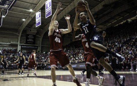 Northwestern guard Reggie Hearn (11) drives past Indiana center Cody Zeller (40) and guard Victor Oladipo (4). Hearn led the Wildcats with 22 points in Sunday's loss.