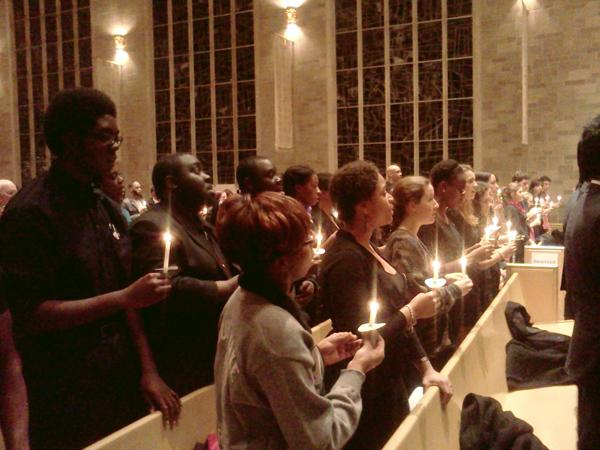 Students in attendance at Monday's vigil held candles and joined the Northwestern Community Ensemble in singing