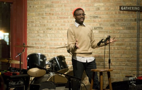 Weinberg sophomore Oluwaseun Ososami, also known as DJ Mufasa the Pilofasa, introduces acts at U NU Arts Night. The program included singing, spoken verse and rapping.