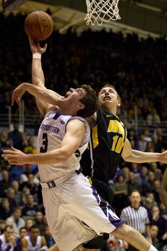 Sophomore point guard Dave Sobolewski attempts a shot during Sundays game against Iowa. Sobolewski led the Wildcats with 14 points in their 70-50 loss, but struggled from the field, hitting only 4-of-11 field goals and zero three pointers.