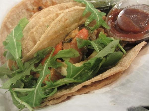 The most flavorful of the tacos on offer at Frontera Fresco, the chipotle shrimp taco is filled with super plump shrimp, avocado and roasted poblano peppers and onions and topped with fresh wild arugula and a bit of lime.