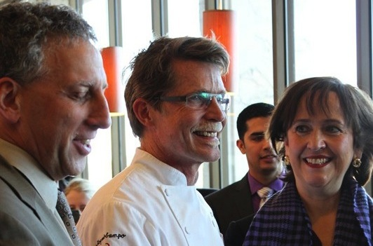 Patricia Telles-Irvin and Provost Daniel Linzer look on as Chef Rick Bayless cuts the ribbon for Frontera Fresco's grand opening celebration on Wednesday in Norris.