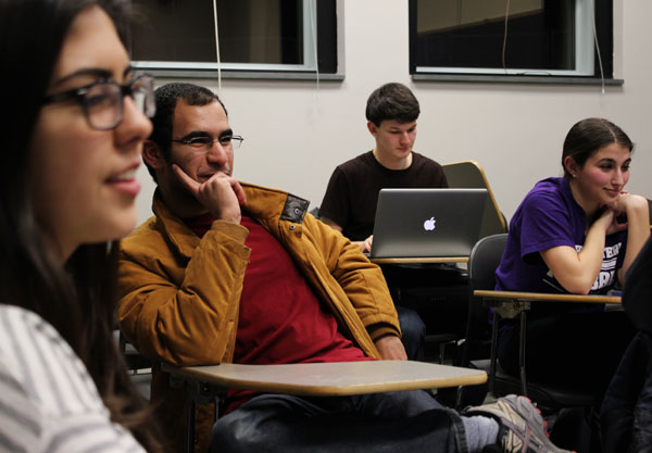 Sophomore Mohamad Akef participates in the gun control debate during the College Democrats meeting. The group also discussed how they would present their views to the Northwestern community.