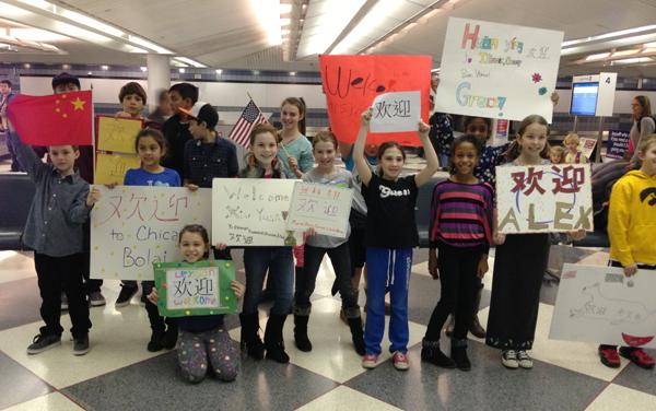 Students from Dr. Bessie Rhodes Magnet School of Global Studies welcome their Beijing pals at the airport. The Chinese students are visiting the Evanston school for a two-week exchange program.