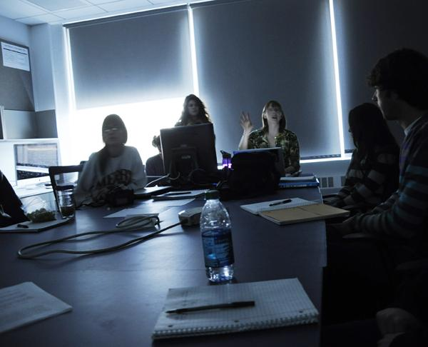 Photojournalism students discuss assignments on a projector. StateUniversity.com named Medill the second most popular Journalism school in 2012, just behind the University of Missouri-Columbia.