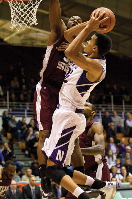 Graduate student Jared Swopshire attempts a shot against Texas Southern. Swopshire and the Wildcats have grown closer as a team since the injuries of senior forward Drew Crawford and senior guard Reggie Hearn sidetracked the season.