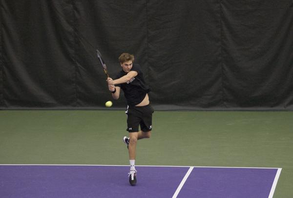 Freshman Fedor Baev completes a return during his singles match. The Wildcats defeated No. 34 Louisville and swept Chicago State on Sunday afternoon.