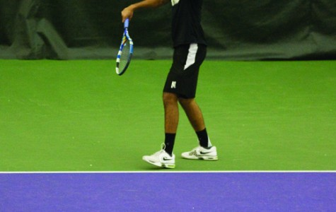 Senior Sidarth Balaji begins a serve. The Wildcats split their matches over the weekend.