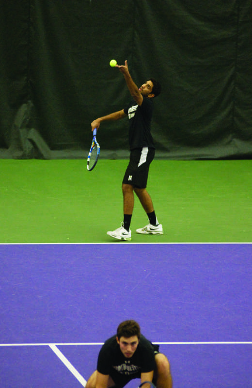 Senior+Sidarth+Balaji+begins+a+serve.+The+Wildcats+split+their+matches+over+the+weekend.