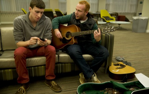 Sophomores Jules Cantor and Jon Ford play guitar and sing in Allison Hall's lounge. The two set up the event to raise money for Josie Nordman's lung transplant.