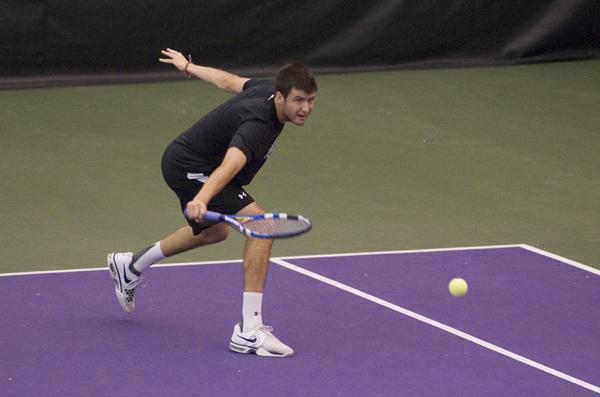 Senior Chris Jackman plays a shot during a recent home match. Jackman and the Wildcats ended their nine-year losing streak to Notre Dame on Tuesday, and remained undefeated this season.