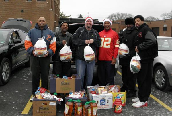 Tracey Wallace, (third from right), created the new group Black Men Against Violence in the aftermath of recent homicides in Evanston. The group has met several times and organized a Christmas Dinner Delivery program for the holidays.