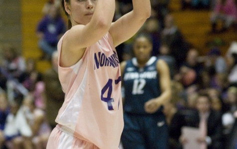 Sophomore Karly Roser attempts a free throw. Roser has averaged 10.6 points and 6.5 assists so far this season.