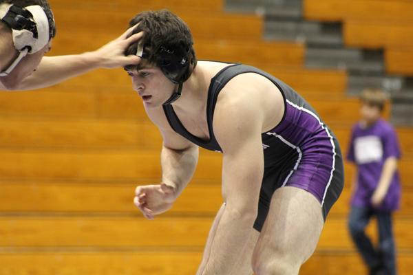 Redshirt sophomore Lee Munster sizes up his opponent from Ohio State. The dual against Ohio State came after a December of mixed results for the Wildcats.