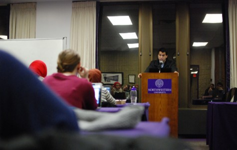 Weinberg senior Girish Pendse presents recommended sanctions on three student groups for violating the Student Activities Finance Committee rules. The vote preceded ASG's discussion of new business regarding wider campus issues including missing  journalist James Foley (Medill '08) and the disaffiliation with Tannenbaum Chabad House.