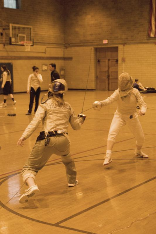 Senior Chloe Grainger practices sabre with a teammate. The Wildcats will face Notre Dame for the third time this weekend.