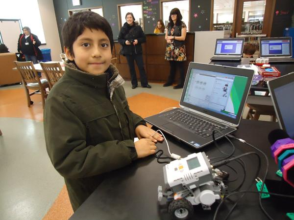 A student participates in a challenge as part of the launch of FUSE at Chicago's Richard M. Daley Library. The program aims to engage students in science and technology-related fields.
