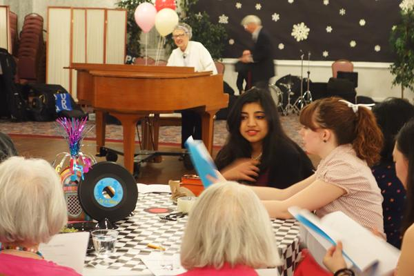 North Shore Retirement Hotel resident Hattie Buell leads a singalong on the piano at NCDC's Senior Gala on Saturday afternoon. This is the second year the event was held off campus.