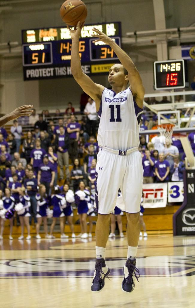 Senior guard Reggie Hearn shoots a jump shot in the second half of Northwesterns 75-60 win over Purdue. Hearn set a career high with 26 points.