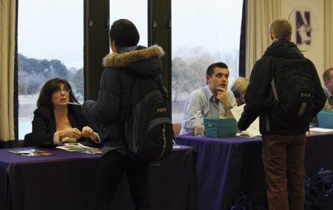 Students speak with landlords and retailers during ASG's Winter Housing Fair. Representatives were available at Norris for students to gather more information about housing options for next year.