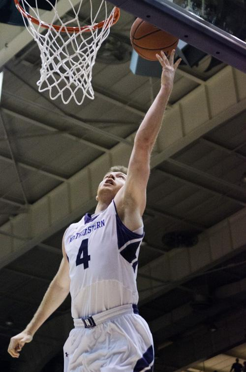 Senior guard Alex Marcotullio attempts a layup. The Wildcats will face Wisconsin on Wednesday night.