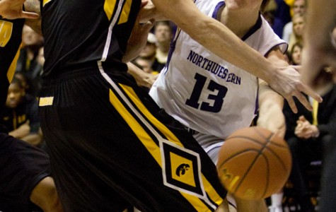 Freshman forward Kale Abrahamson drives into the lane against Iowa. Abrahamson is one of only seven healthy scholarship players left on the Wildcats' roster for the game against Ohio State.