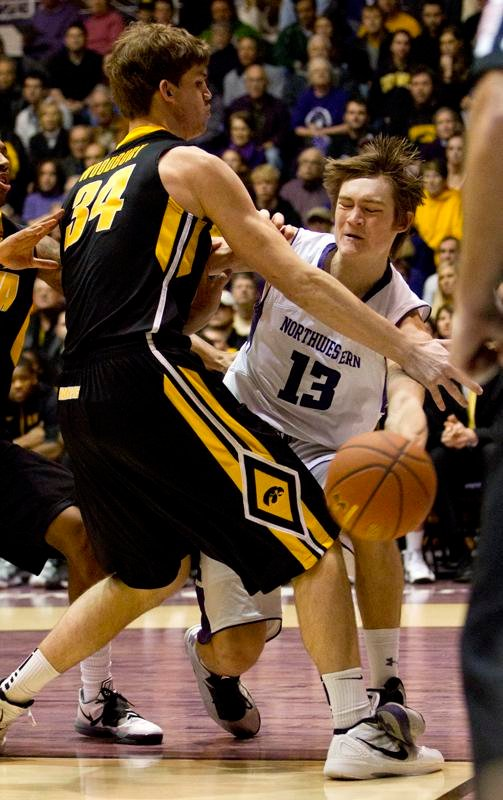 Freshman+forward+Kale+Abrahamson+drives+into+the+lane+against+Iowa.+Abrahamson+is+one+of+only+seven+healthy+scholarship+players+left+on+the+Wildcats%27+roster+for+the+game+against+Ohio+State.+