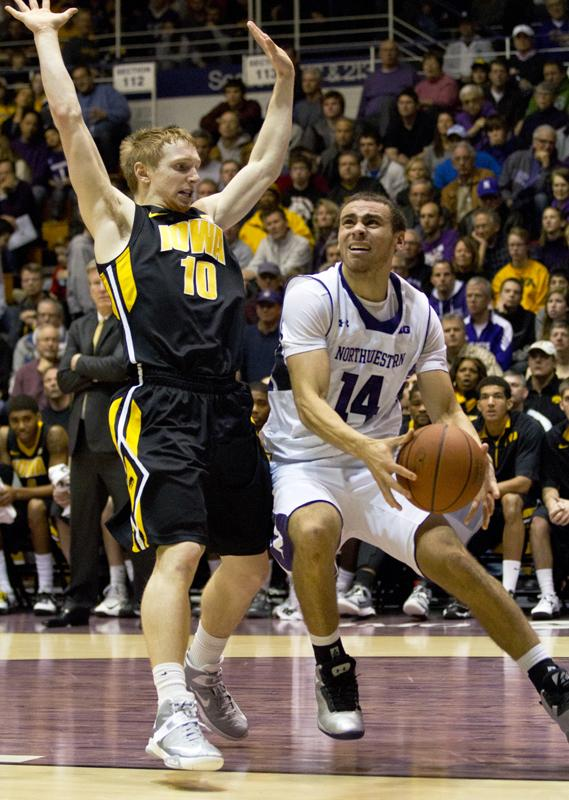 redshirt freshman tre demps drives to the hoop demps led northwestern in scoring with 9