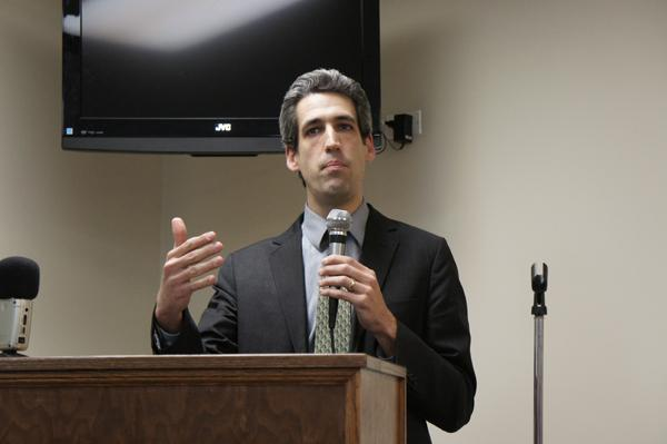 State Sen. Daniel Biss (D-Evanston) explains his pension reform plan to 300 people at a town hall meeting in Wilmette on Monday. Biss is among a group of Illinois Democrats sponsoring two bills to reform the state's underfunded pension system.