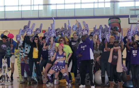 Northwestern students jam to the Harlem Shake in SPAC Gymnasium to show off their school pride before the men's basketball game later that night.  The Harlem Shake is a song by Baauer, a Brooklyn-based DJ, and thousands of renditions of the dance have been added to the Internet.
