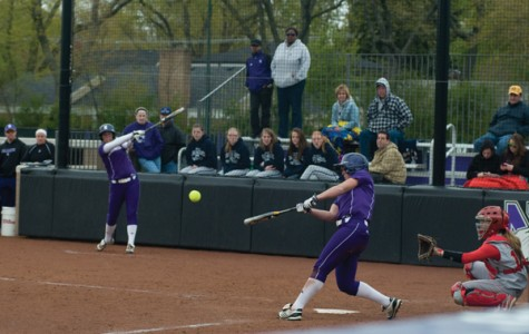 Sophomore outfielder Olivia Duehr takes a swing during a game last season. The Wildcats lost four out of their first five to kick off 2013.