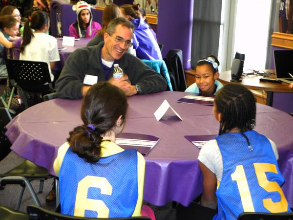 Women's Swimming coach Jimmy Tierney talks with three young female athletes. Tierney, along with three other Northwestern coaches, participated in roundtable discussions for NU's second annual celebration of National Girls and Women in Sports Day.