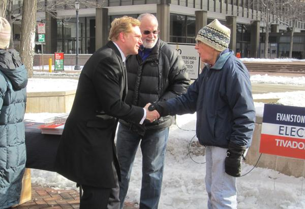 1st Ward candidate Edward Tivador talks to an Evanston resident after launching his campaign to unseat Ald. Judy Fiske on Saturday in downtown Evanston's Fountain Square.