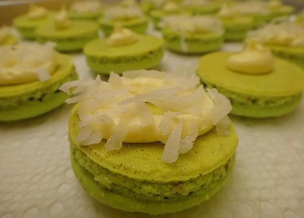 Coconut pandan macarons cool before they are topped off. House of Waldorf creator Jack Meir combines French macarons with Filipino flavors.