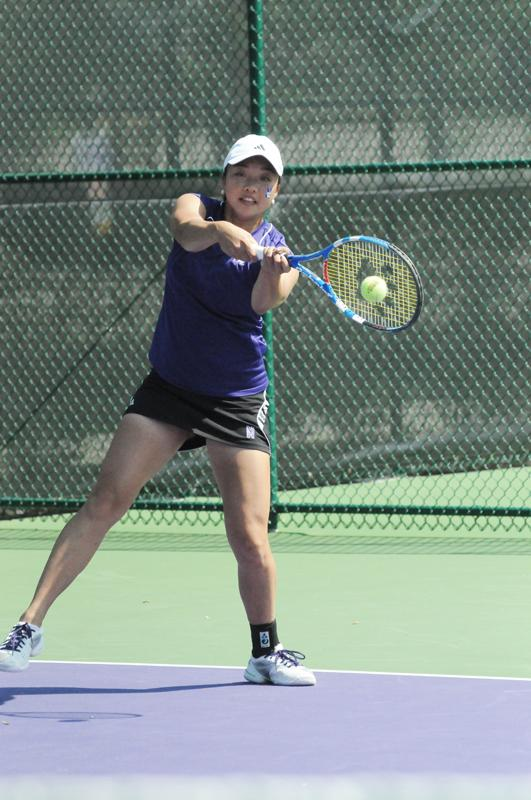 Junior Belinda Niu plays a shot during a match last season. The Wildcats won two out of three matches last weekend in Charlottsville, Va.