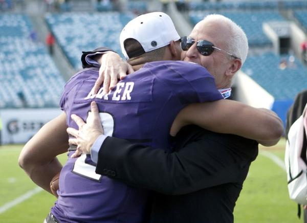 After finally breaking the drought, quarterback Kain Colter celebrated with University president Morton Schapiro.